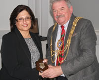 Nasim receiving the plaque from the Mayor of Brighton & Hove Cllr Bill Randall.
